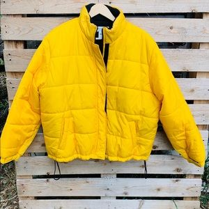 Vintage yellow puffer jacket .